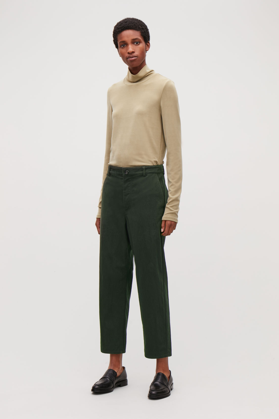 Model front image of Cos relaxed button-up chinos in green
