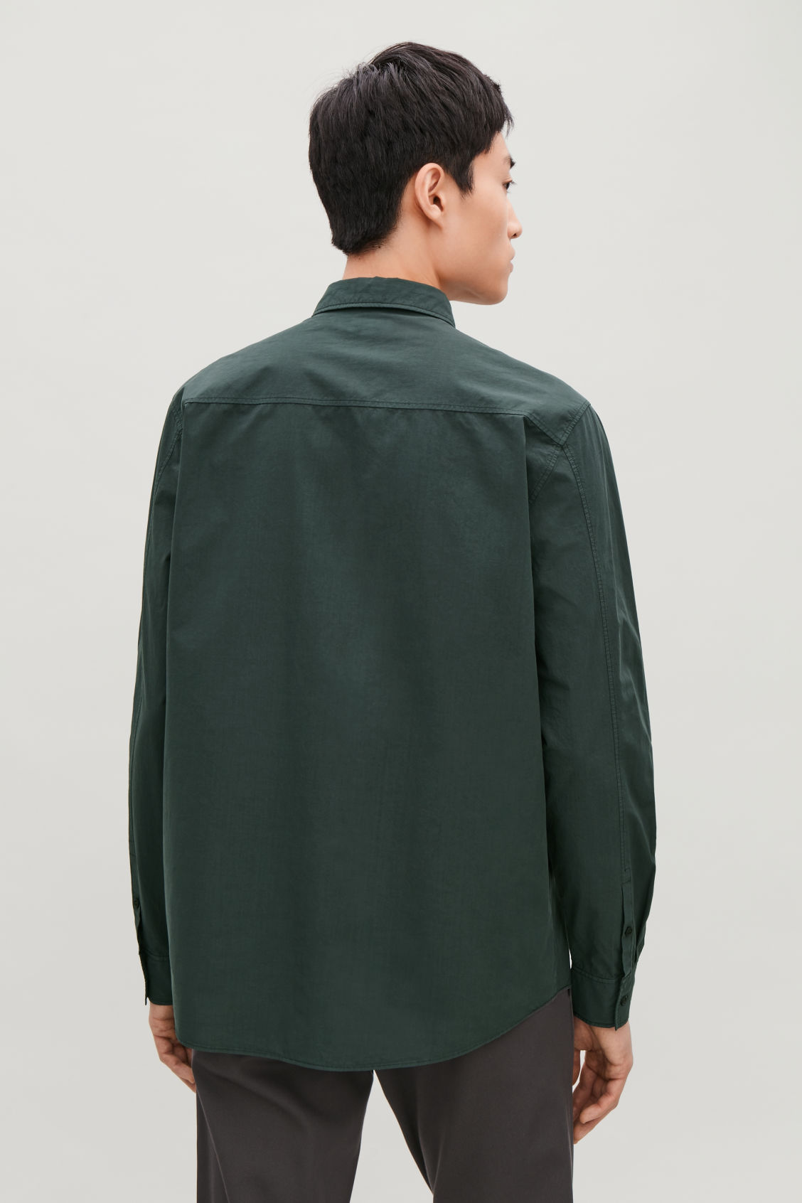 Model side image of Cos washed-cotton shirt in green