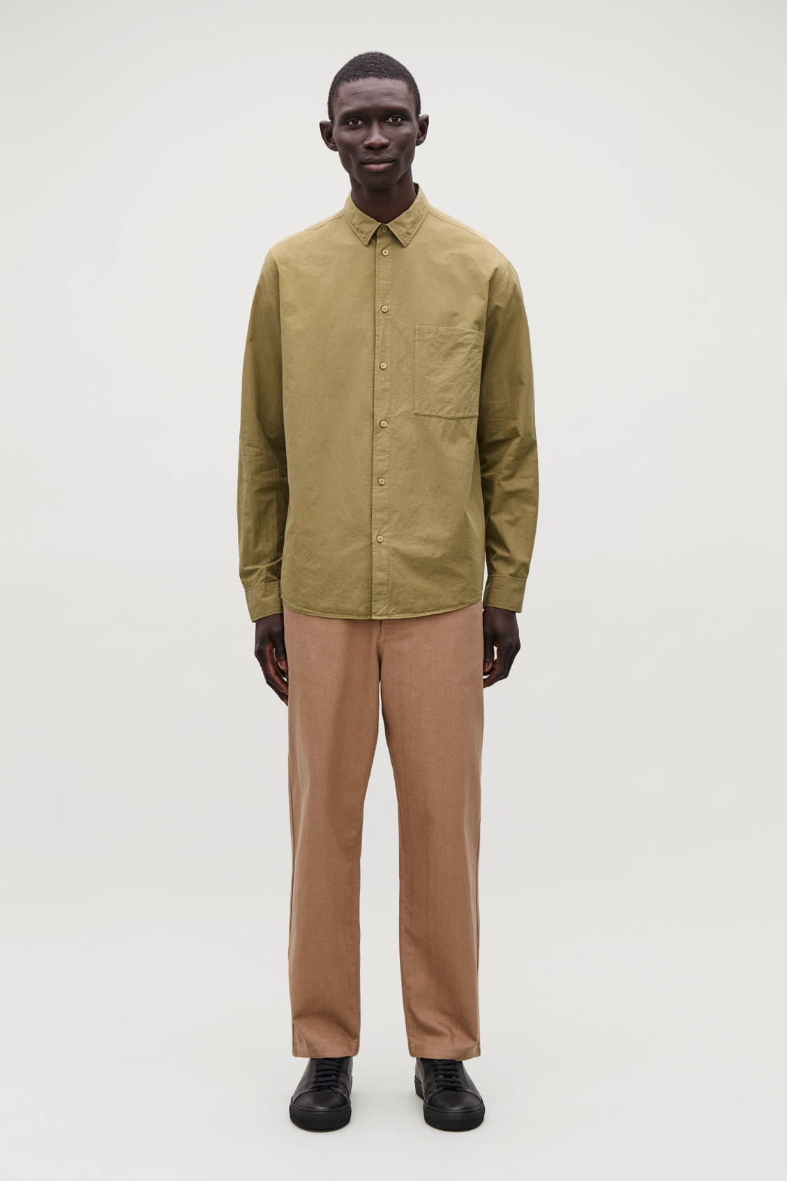 Model front image of Cos washed-cotton shirt in yellow