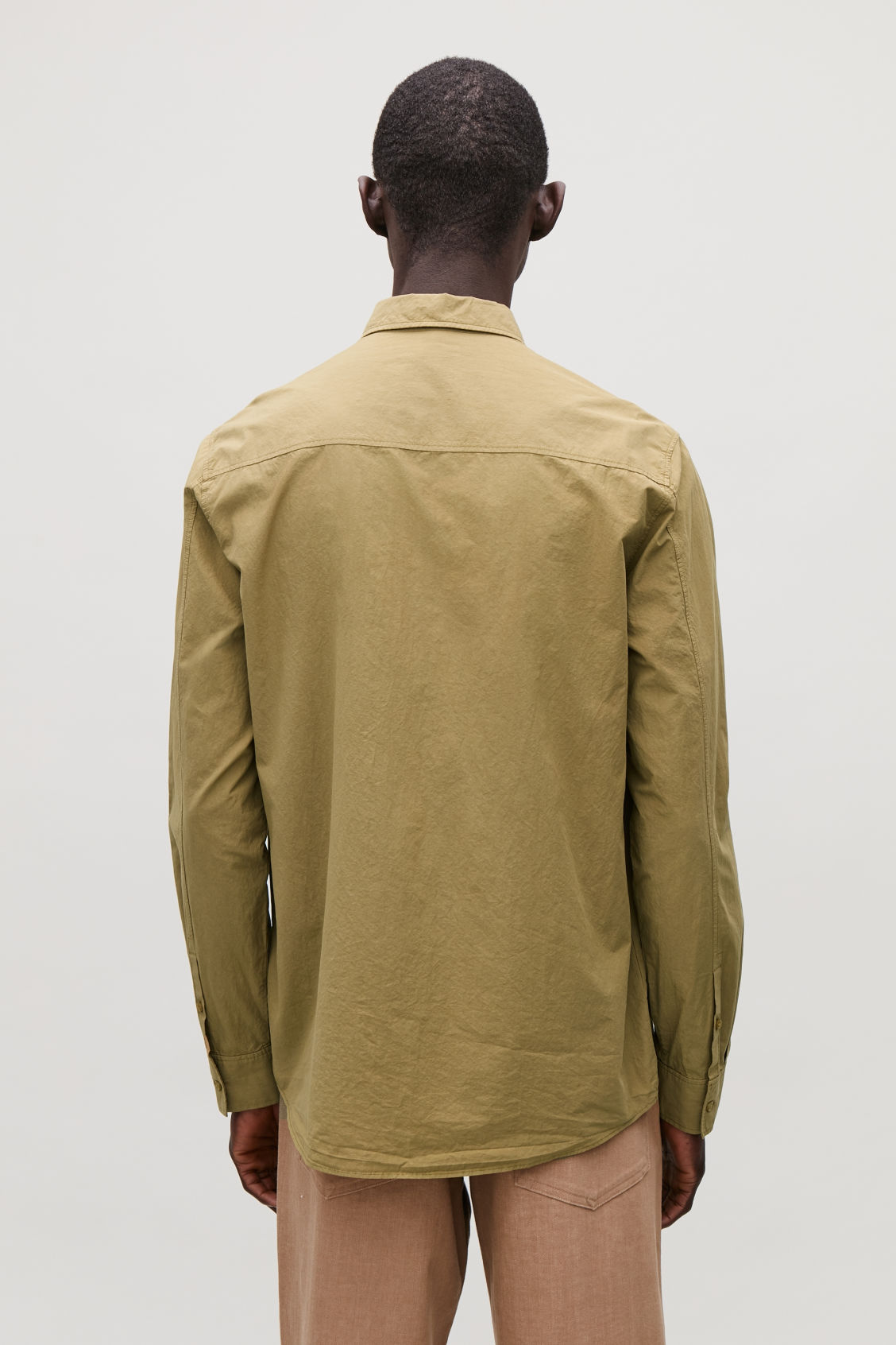 Model side image of Cos washed-cotton shirt in yellow