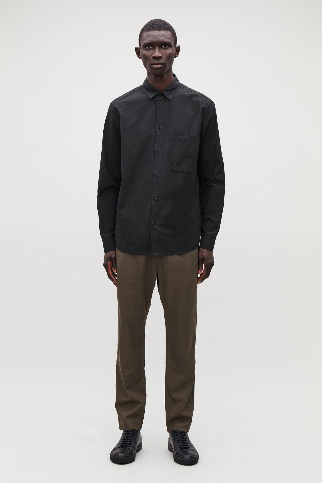 Model front image of Cos washed-cotton shirt in black