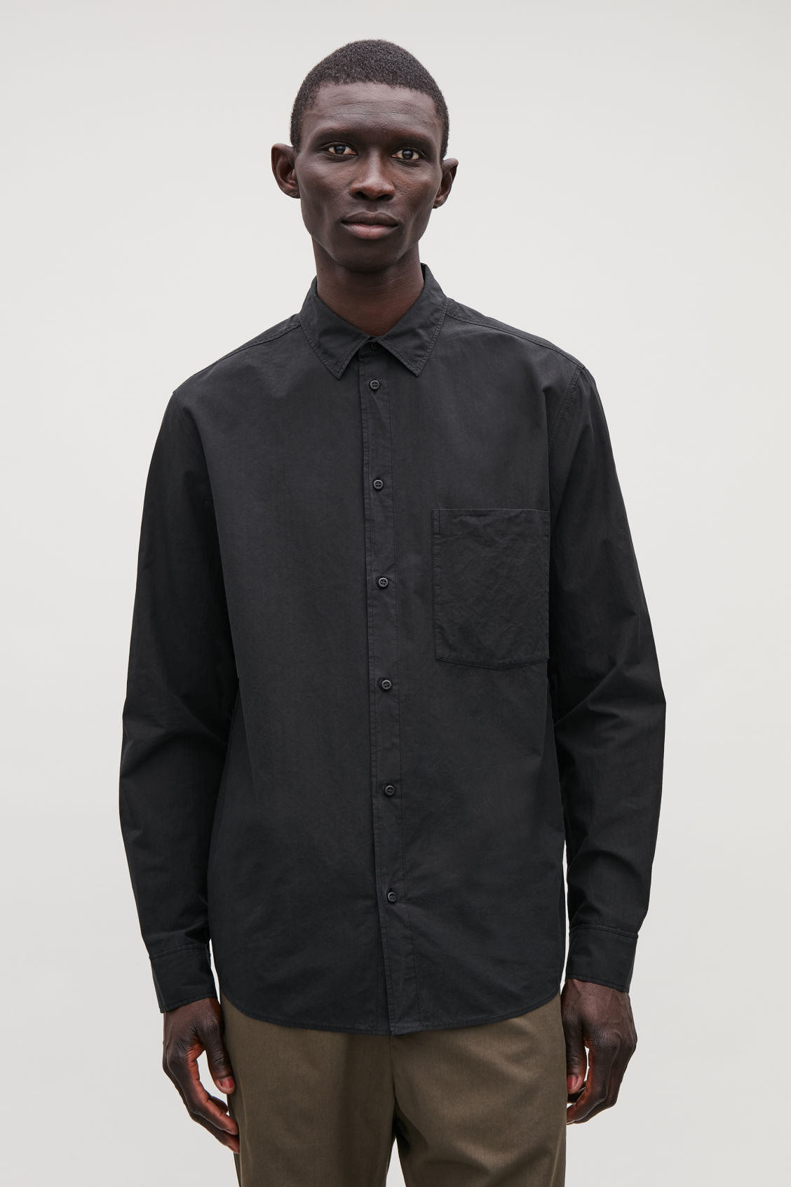 Model side image of Cos washed-cotton shirt in black
