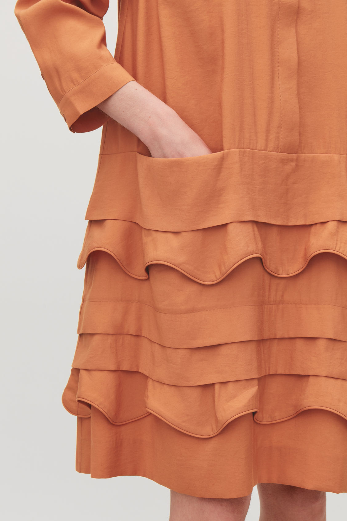 Model side image of Cos scallop-trim layered dress in orange