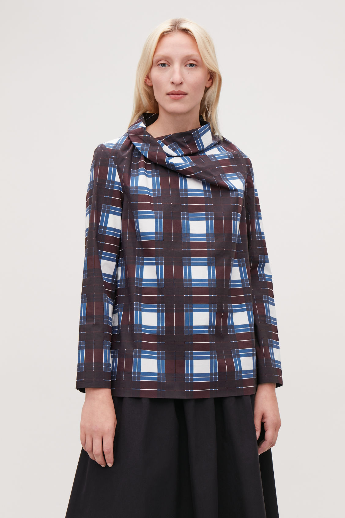 Model side image of Cos draped-neck checked top in burgundy