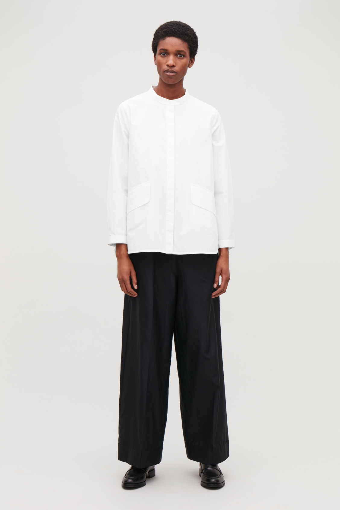 Model front image of Cos voluminous shirt with pockets in white