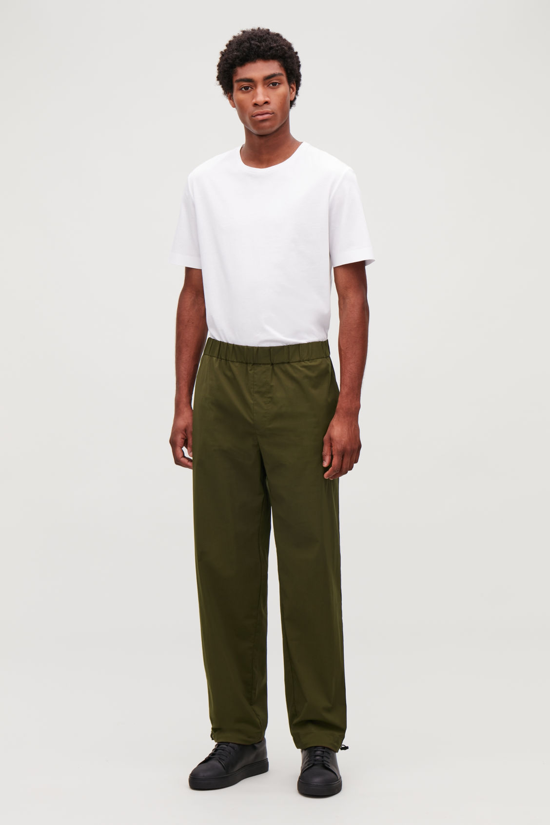 Model front image of Cos light elasticated trousers in green