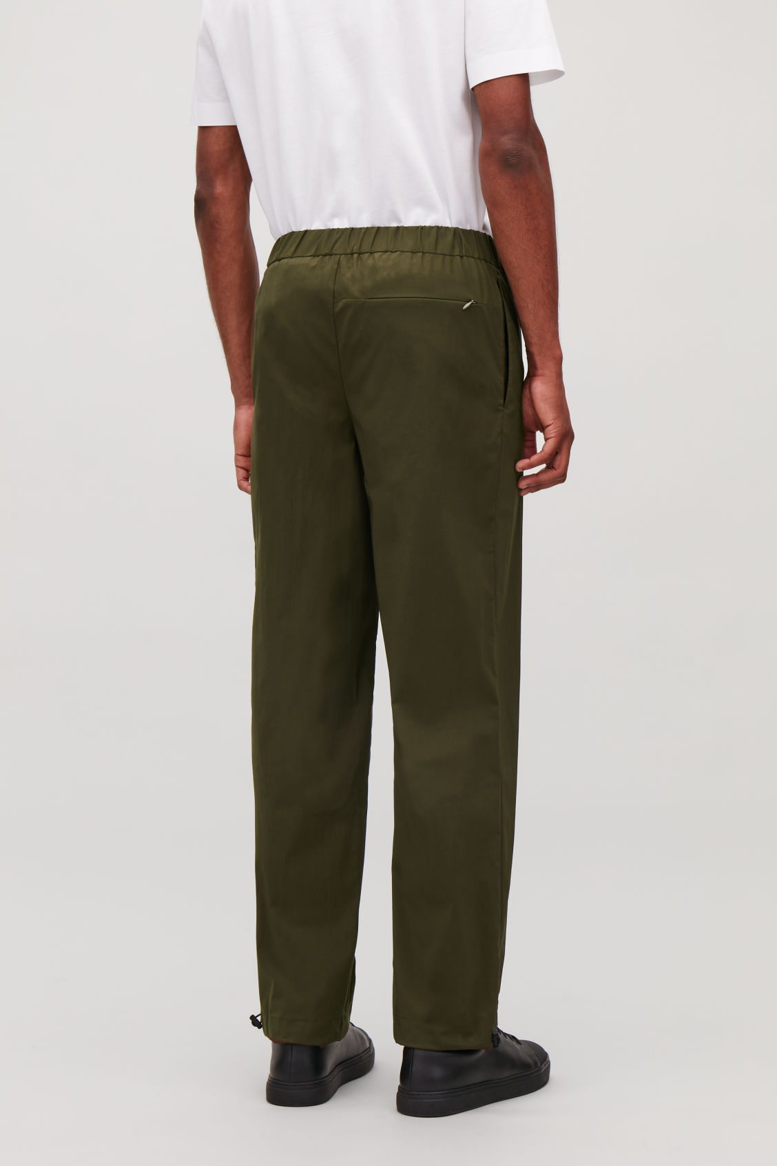 Model side image of Cos light elasticated trousers in green