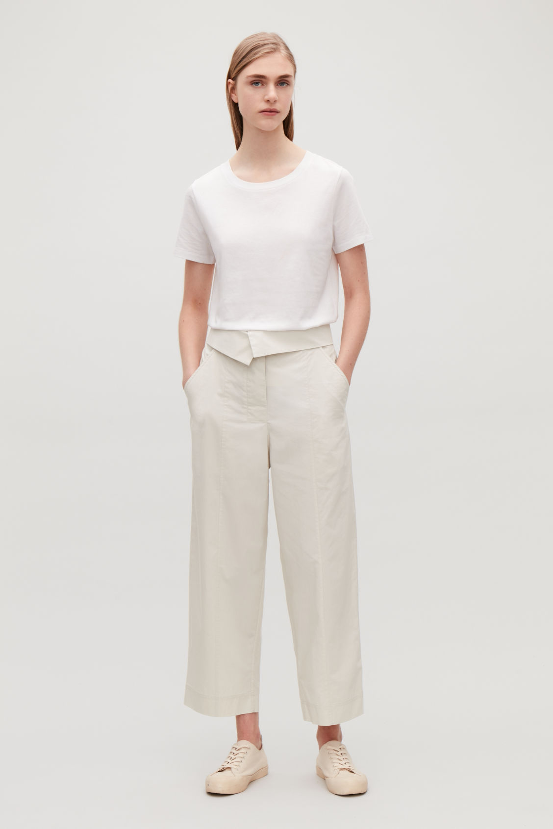Model front image of Cos trousers with folded waistband in beige