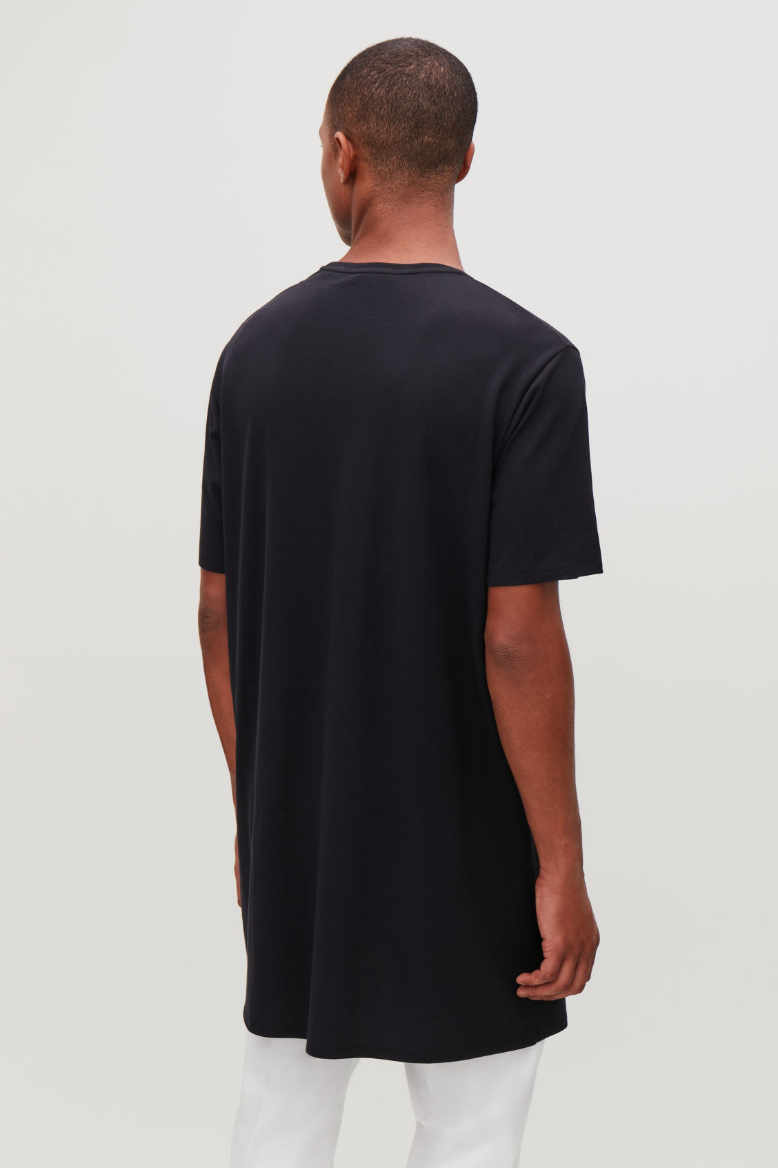 Model side image of Cos long round-neck t-shirt  in blue