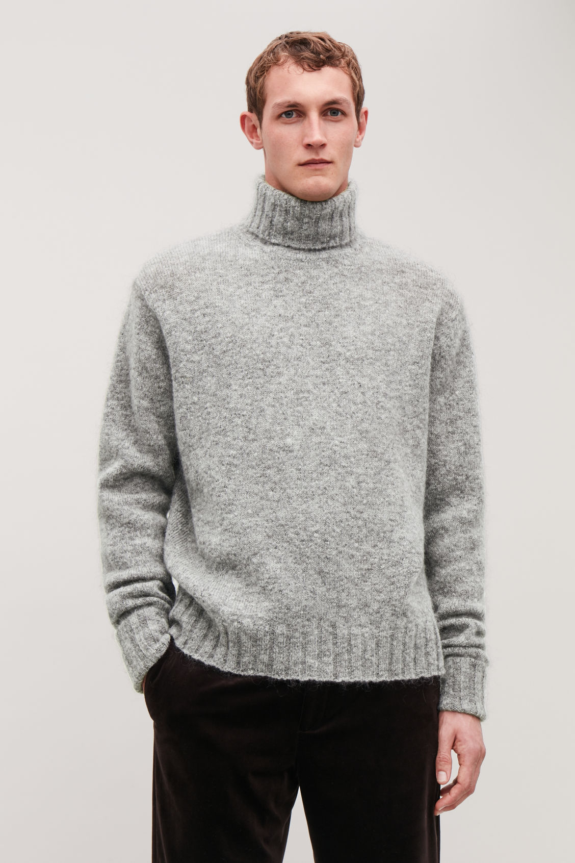 Model side image of Cos chunky roll-neck jumper in grey