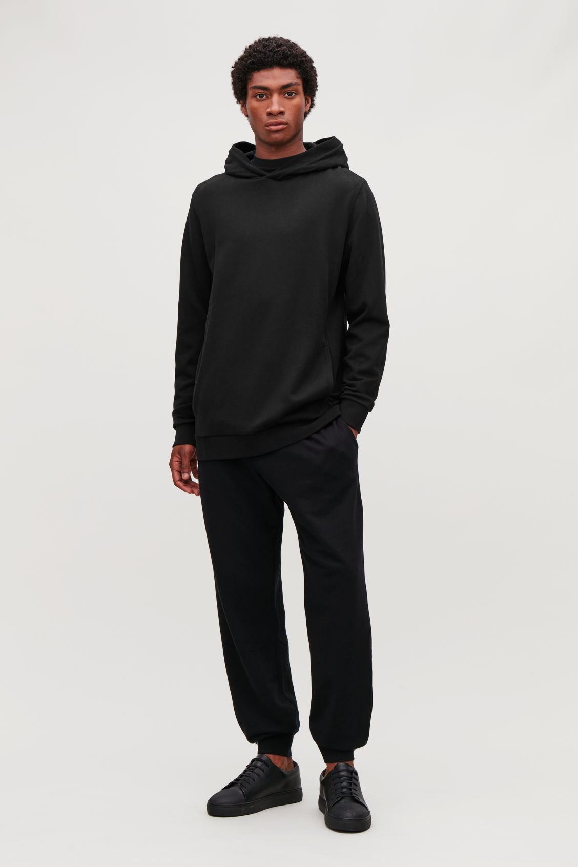 Model front image of Cos cotton hooded jumper in black