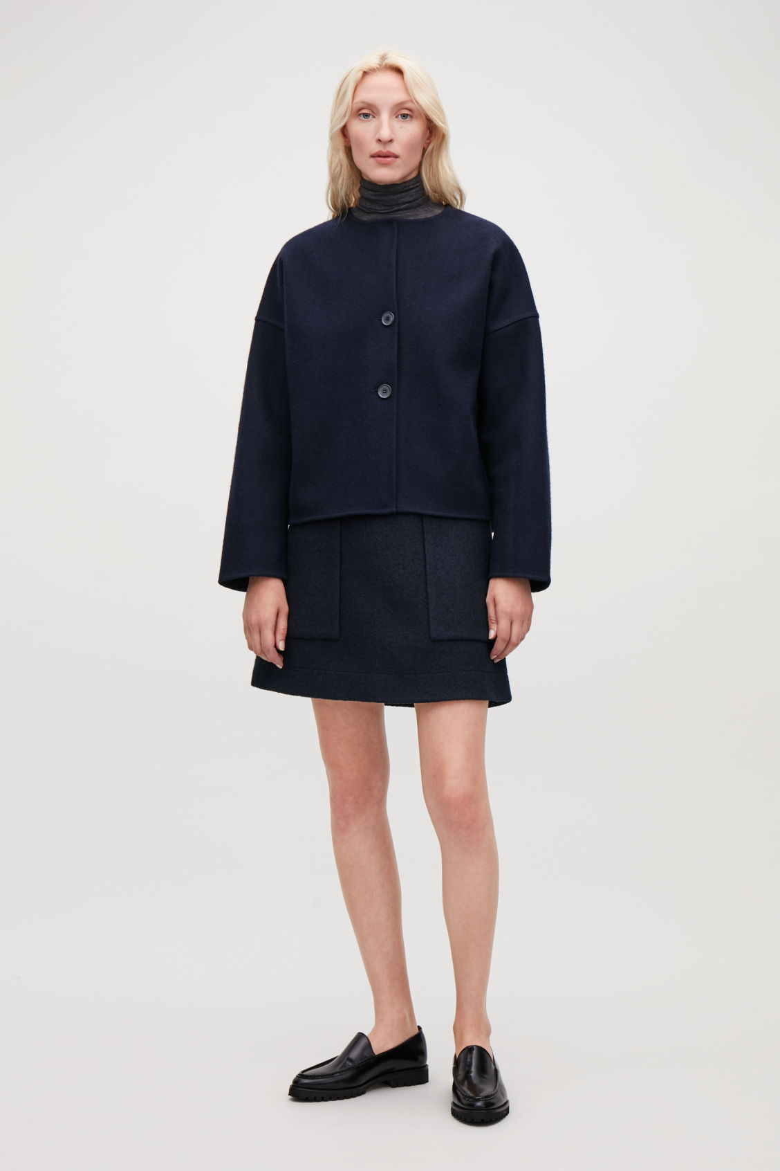 Model front image of Cos boiled wool a-line skirt  in blue