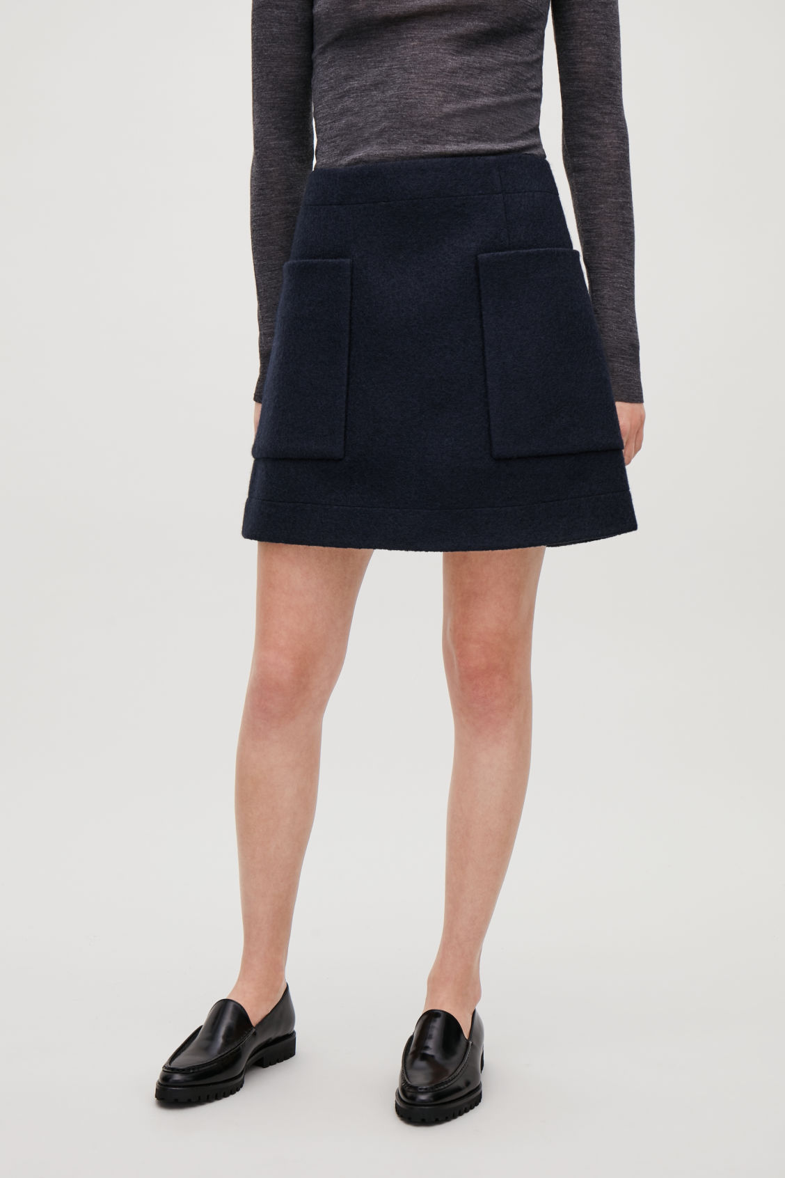 Model side image of Cos boiled wool a-line skirt  in blue