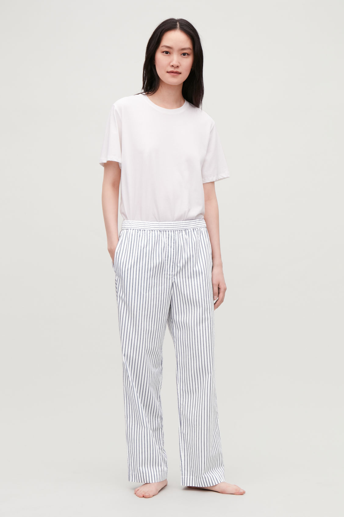 Model front image of Cos slim striped pyjama trousers in blue