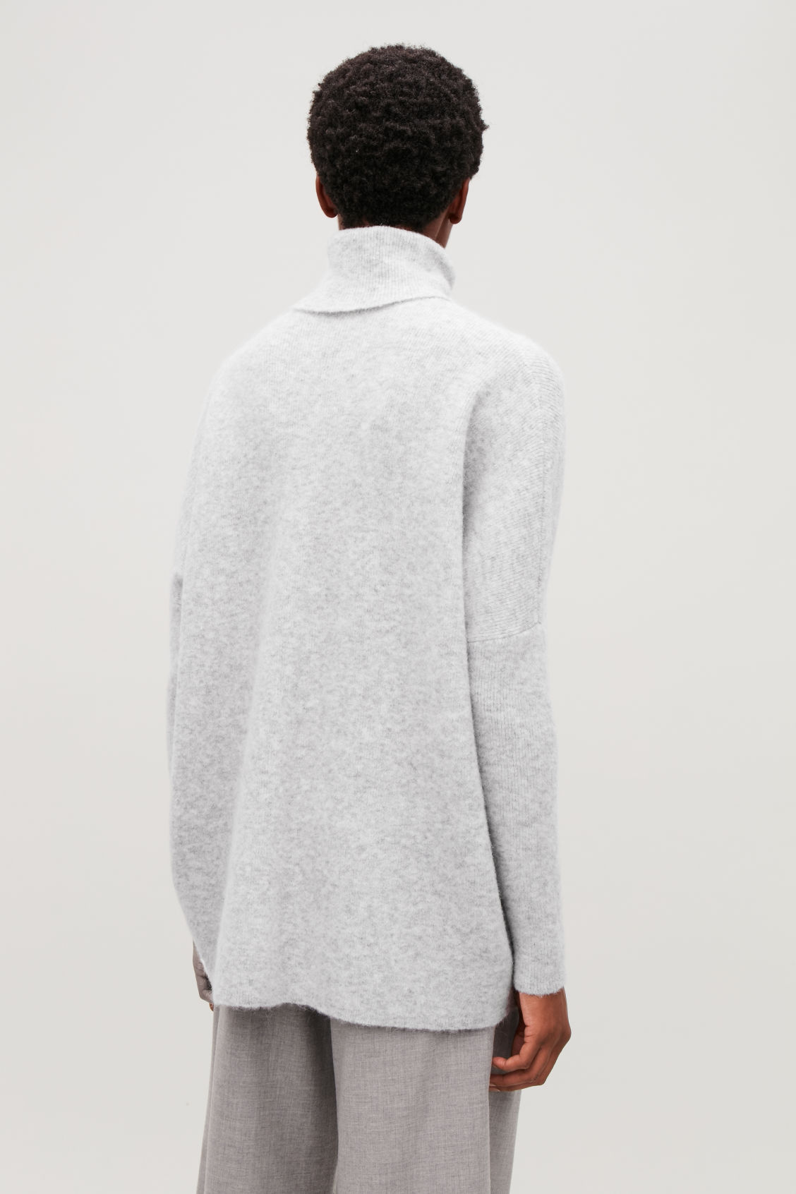 Model side image of Cos alpaca-blend tunic jumper in grey