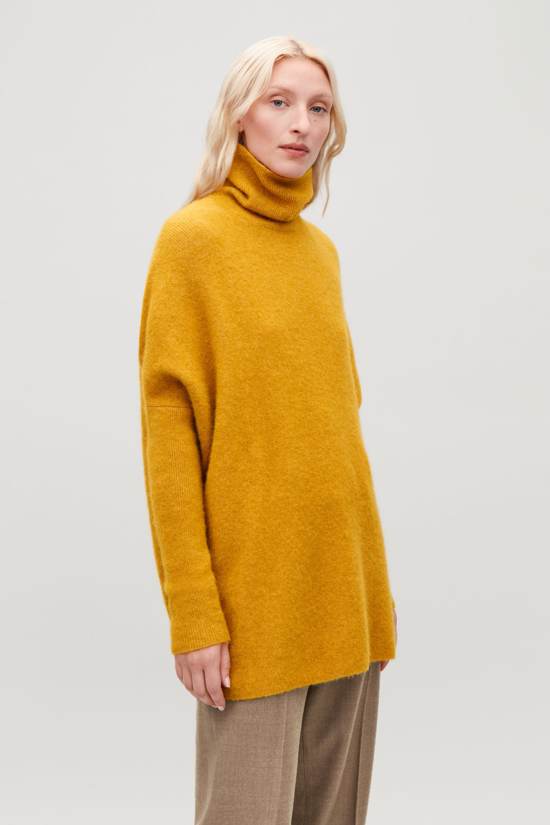 Model side image of Cos alpaca-blend tunic jumper in yellow