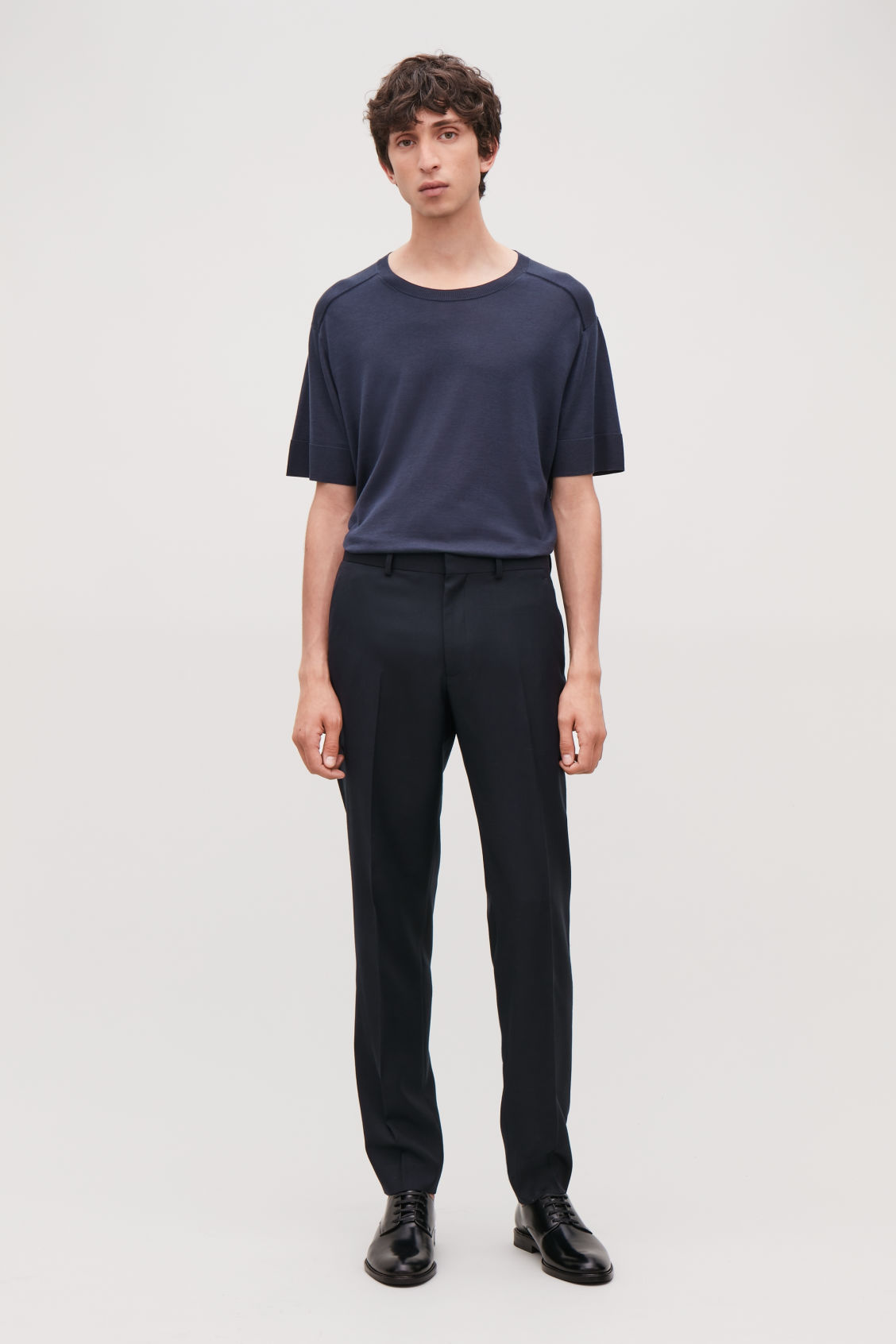 Model front image of Cos regular-fit wool trousers in blue