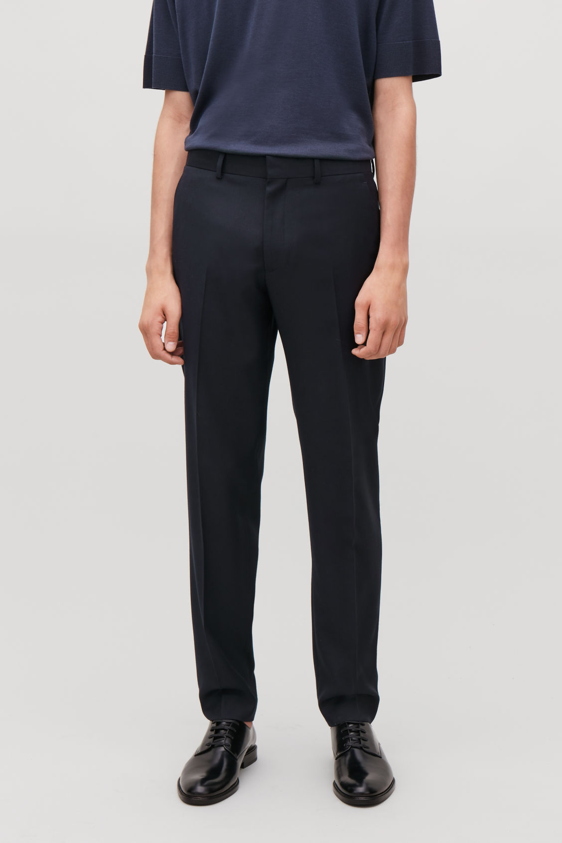 Model side image of Cos regular-fit wool trousers in blue