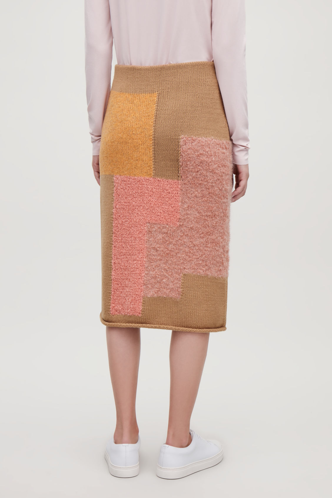 Model side image of Cos patchwork wool pencil skirt in beige