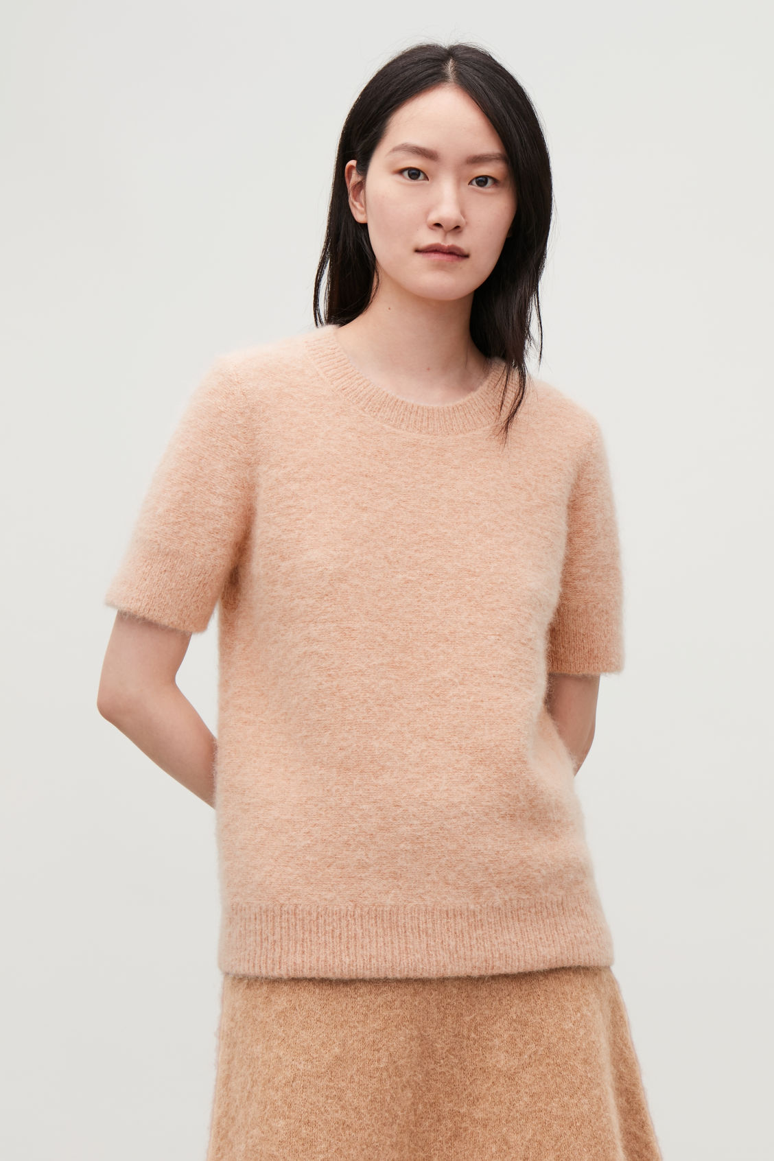 Model side image of Cos textured knitted t-shirt in beige