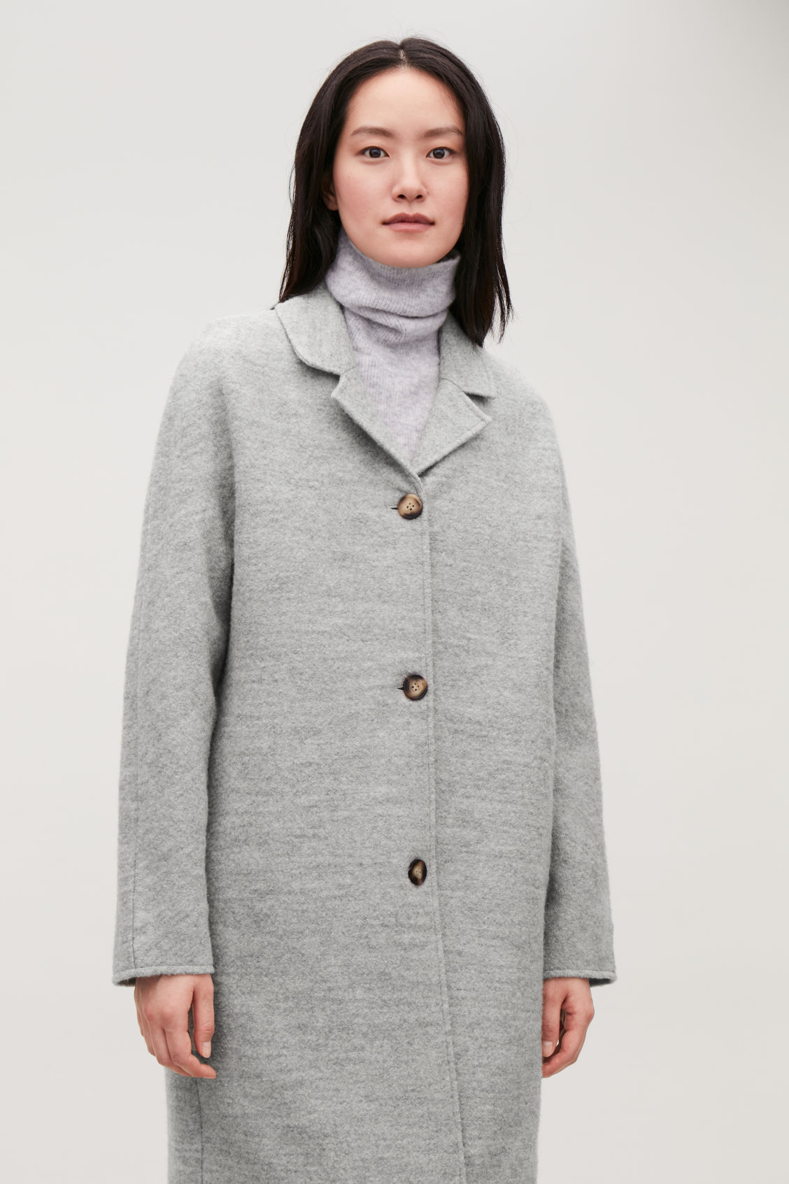 Model side image of Cos single-breasted jersey car coat in grey