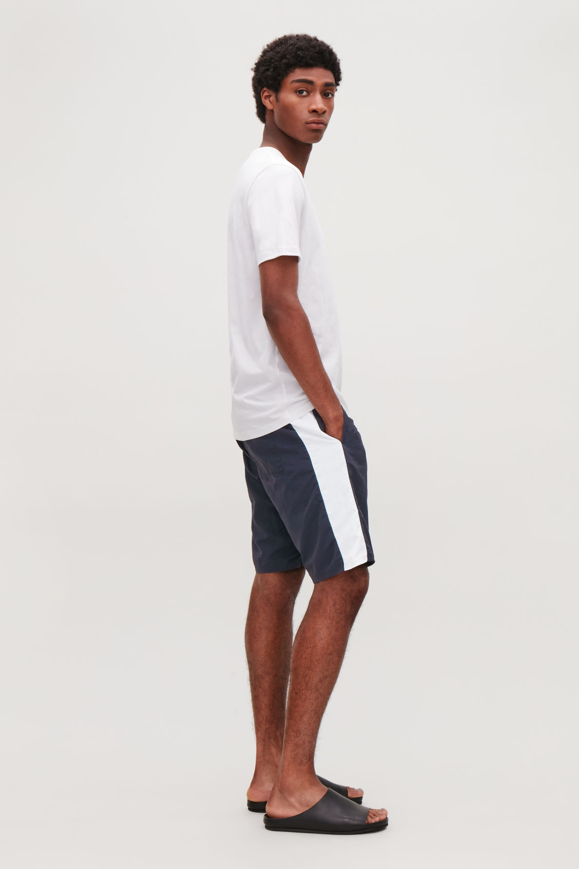 Model front image of Cos slim-fit swim shorts in blue