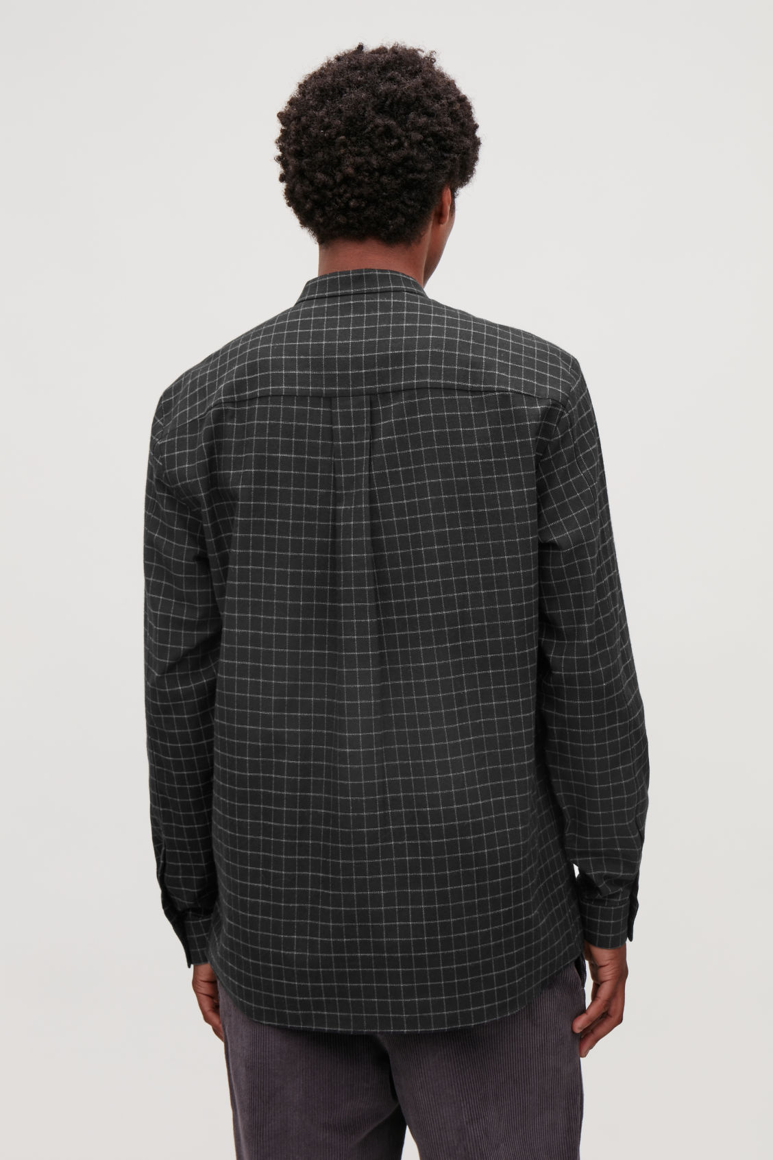 Model side image of Cos checked grandad-collar shirt in black
