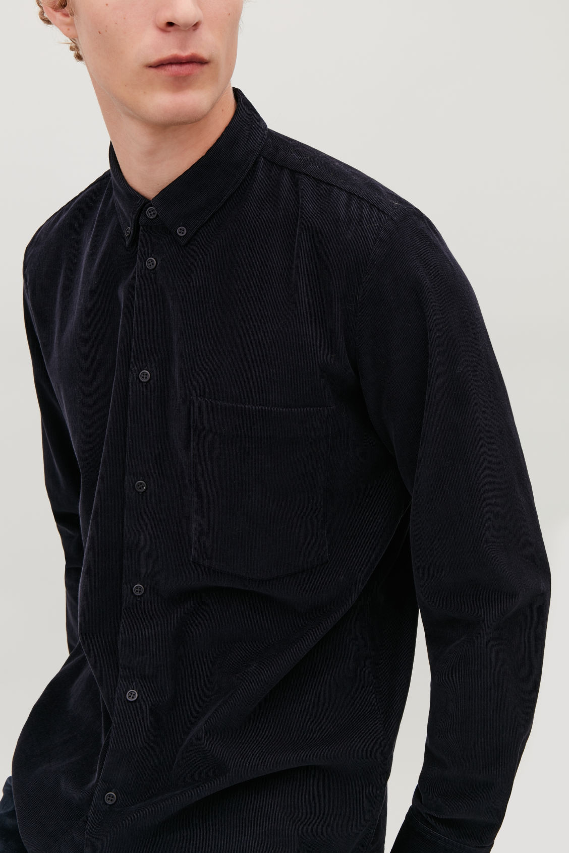 Model side image of Cos corduroy shirt in blue