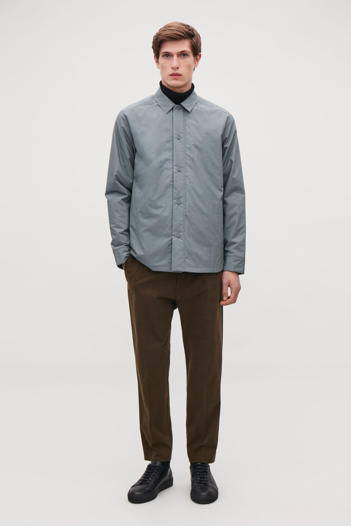 Model side image of Cos slim-fit moleskin trousers in brown