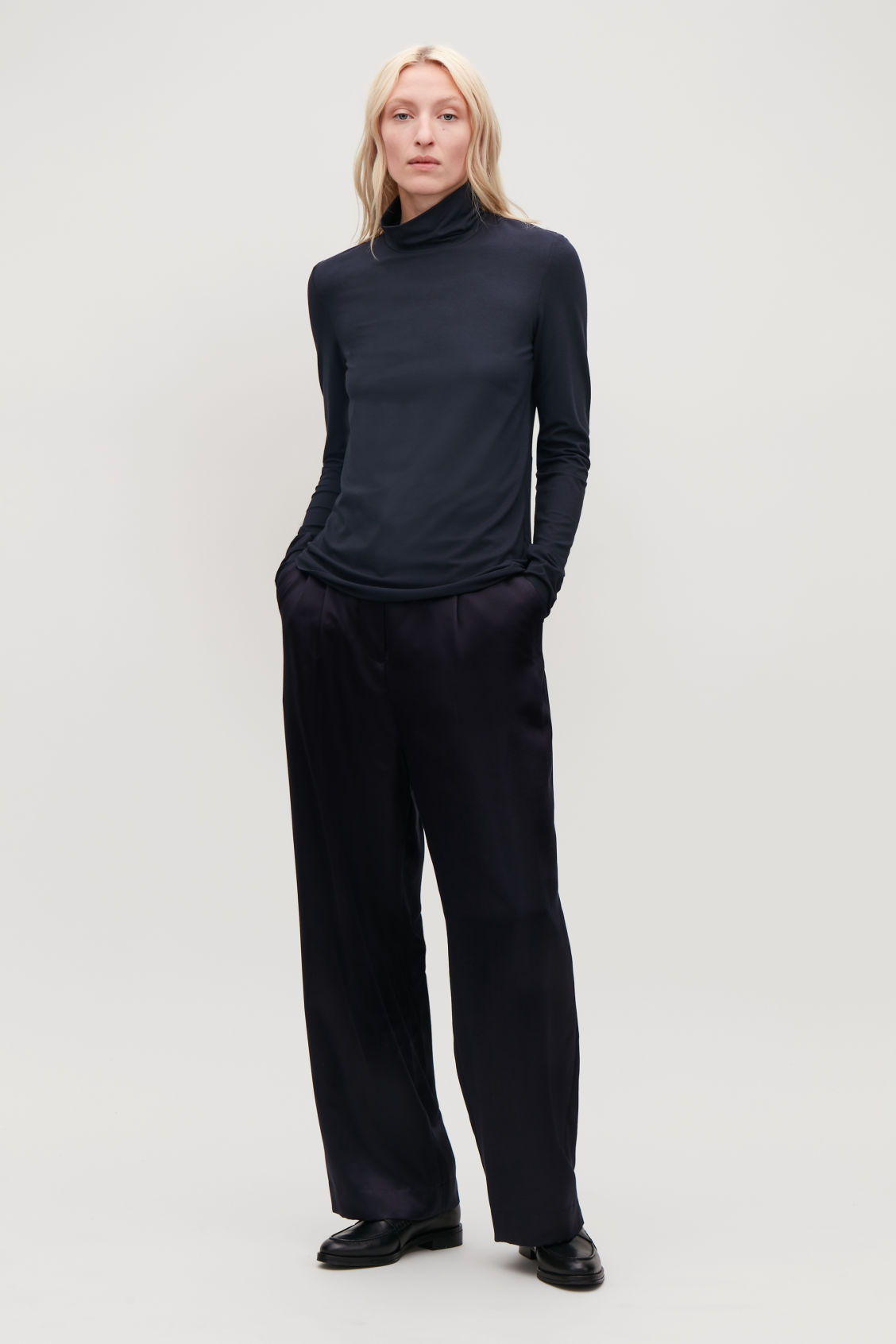 Model front image of Cos jersey roll-neck top in blue