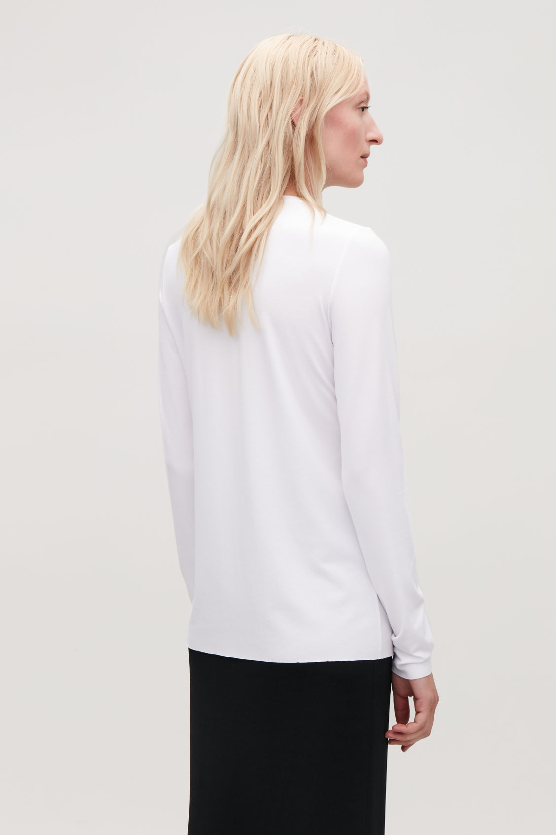 Model side image of Cos long-sleeved jersey top in white