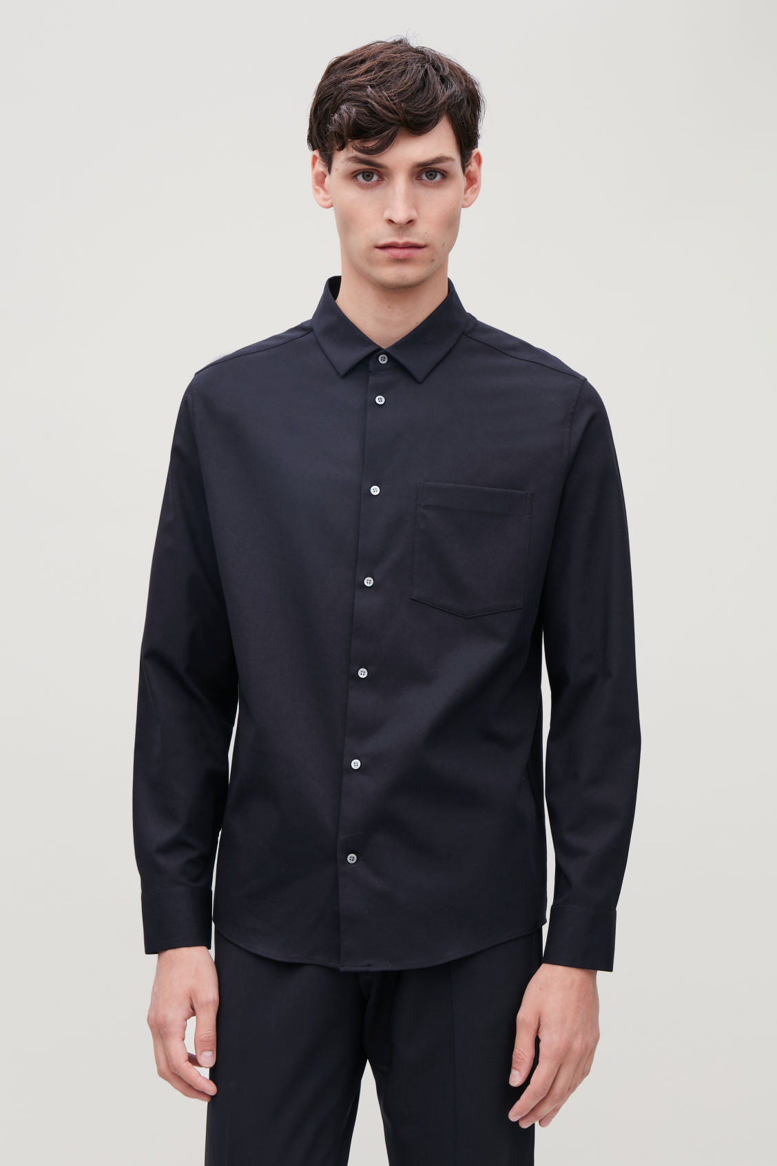 Model side image of Cos long-sleeved cotton shirt in blue