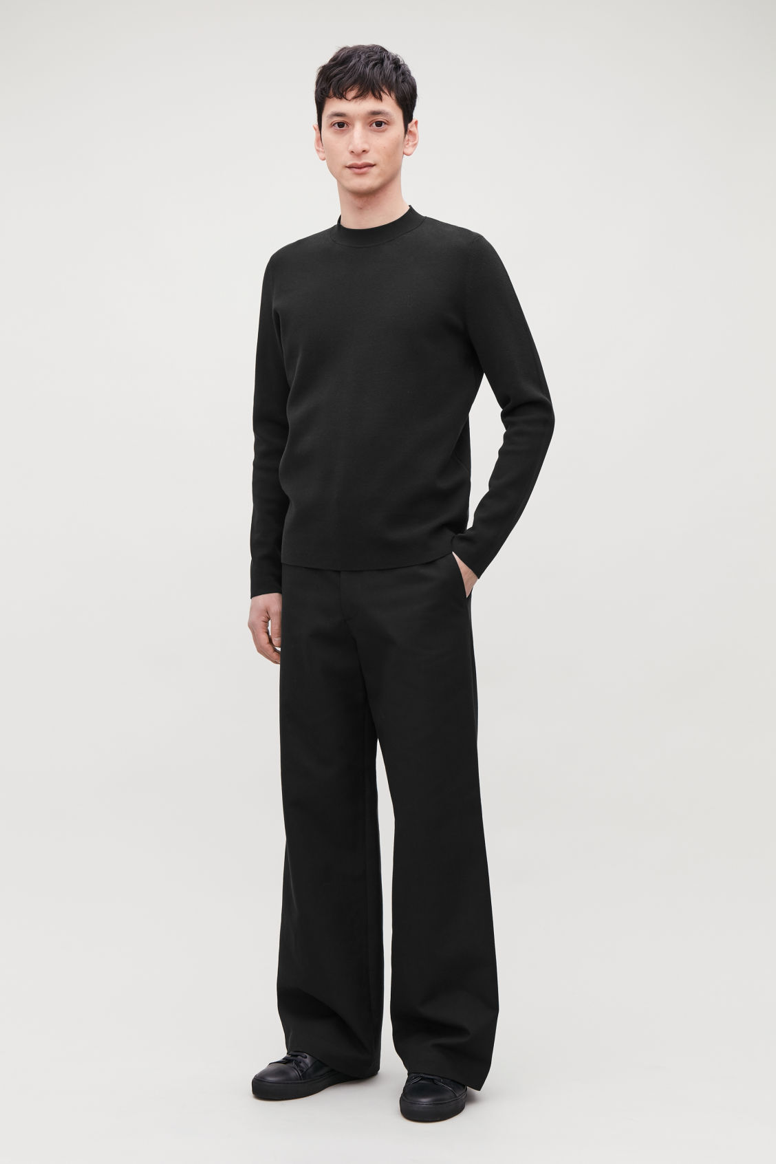 Model front image of Cos flared cotton-wool trousers in black