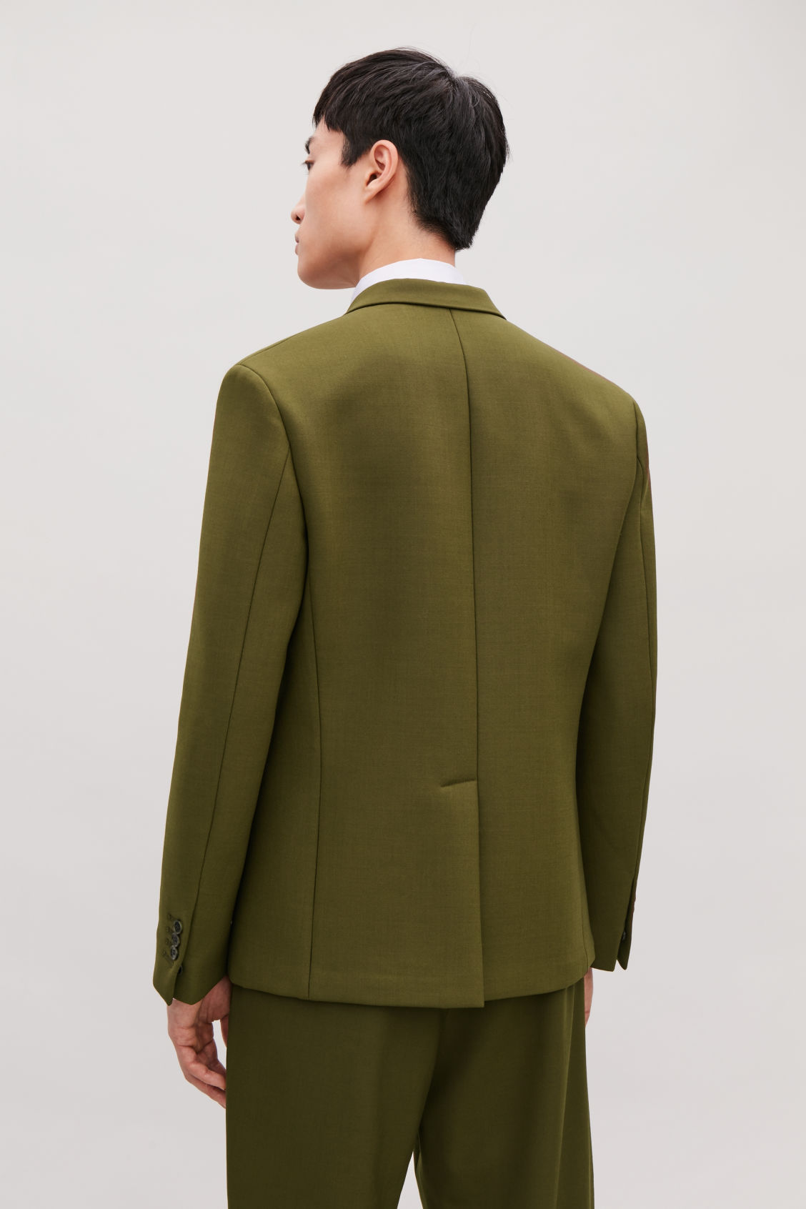 Model side image of Cos padded slim fit blazer in green