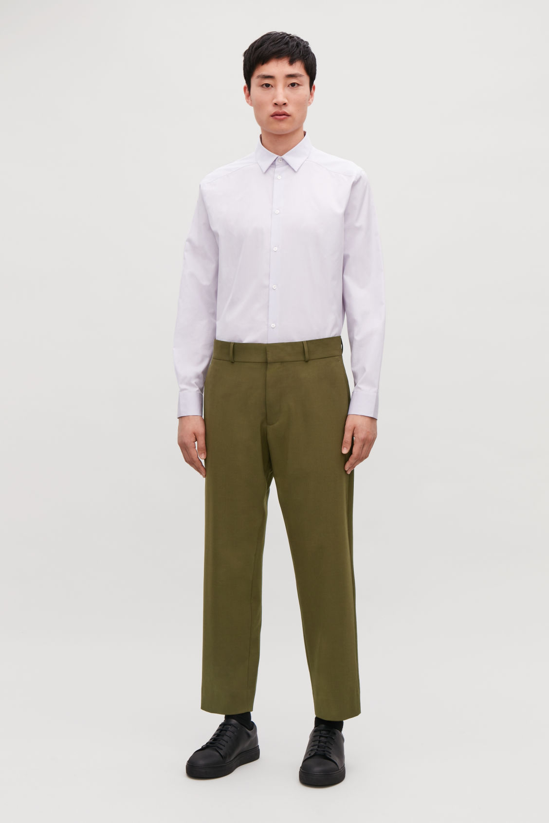 Model front image of Cos cropped wool trousers in green