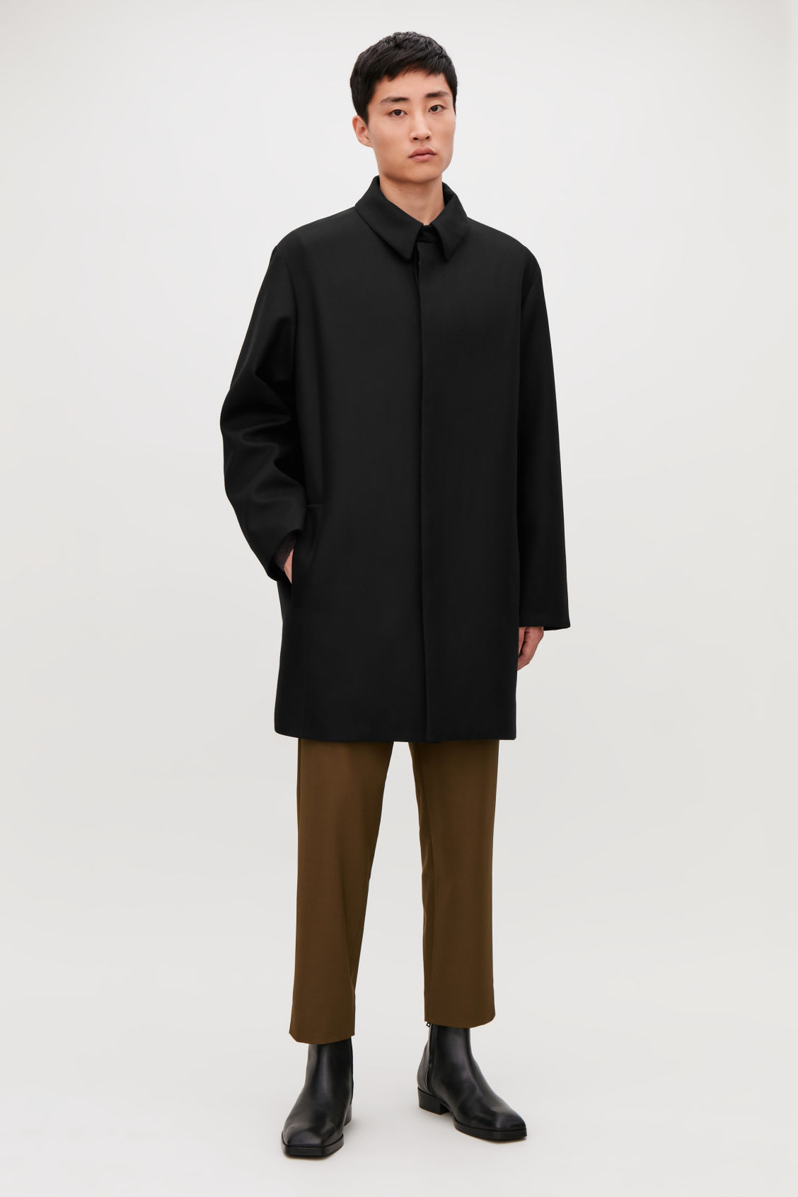Model front image of Cos single-breasted wool mac in black
