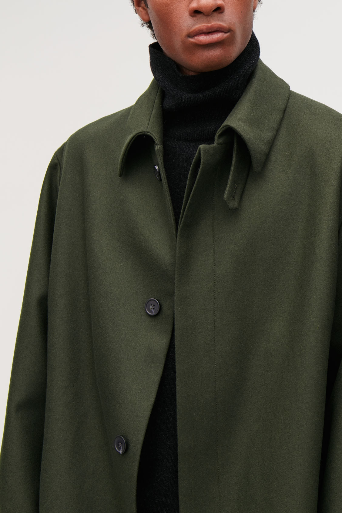 Model side image of Cos single-breasted wool mac in green