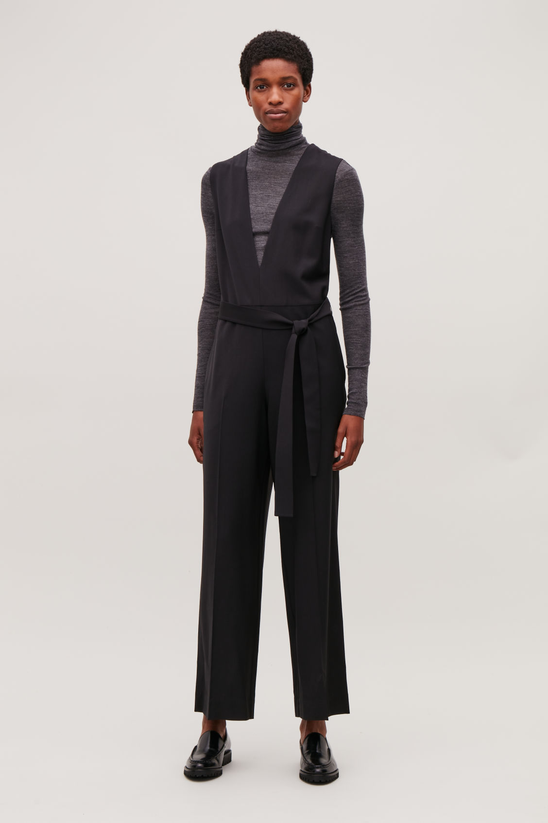 Model front image of Cos deep v-neck tailored jumpsuit  in black