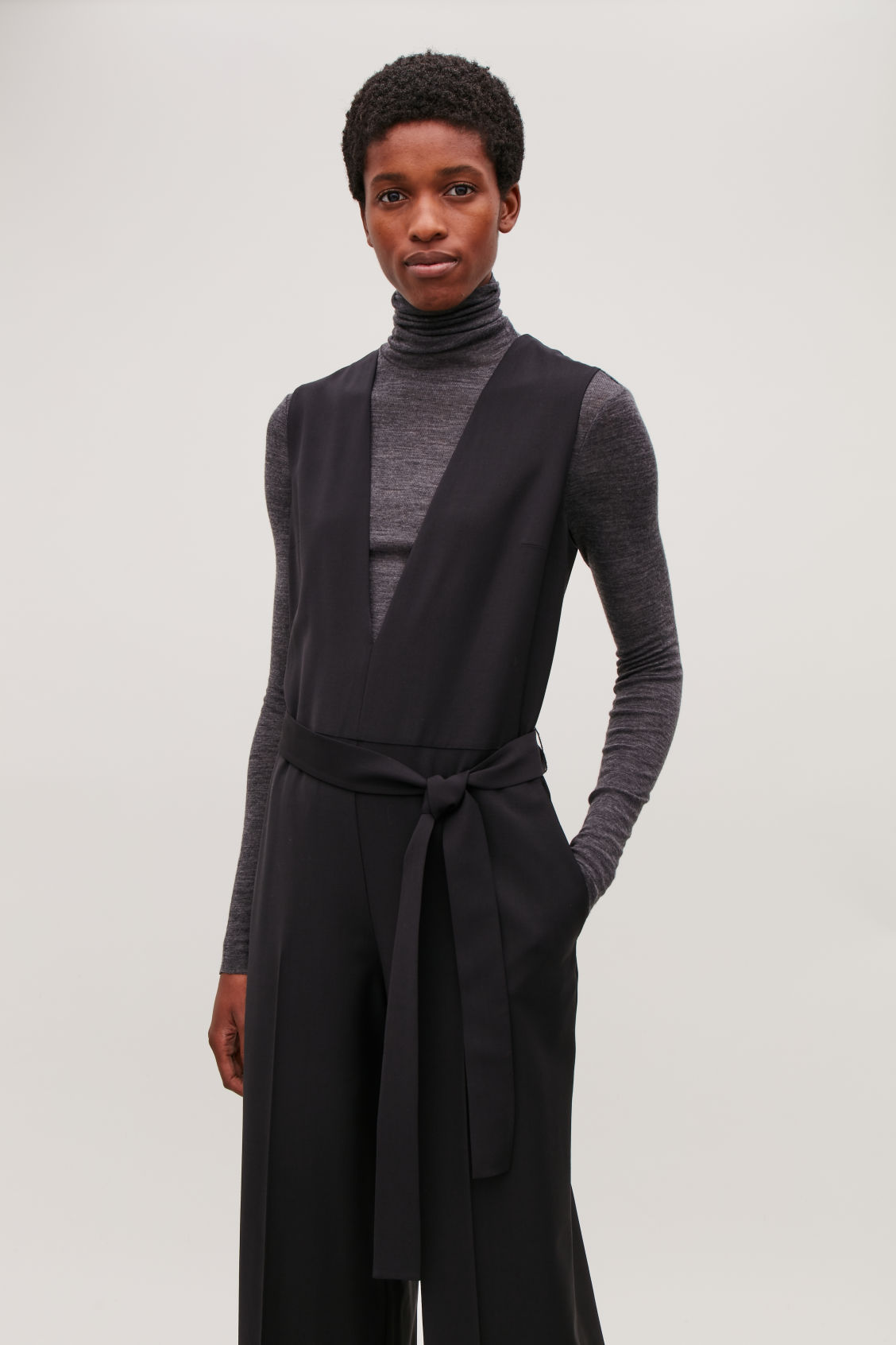 Model side image of Cos deep v-neck tailored jumpsuit  in black