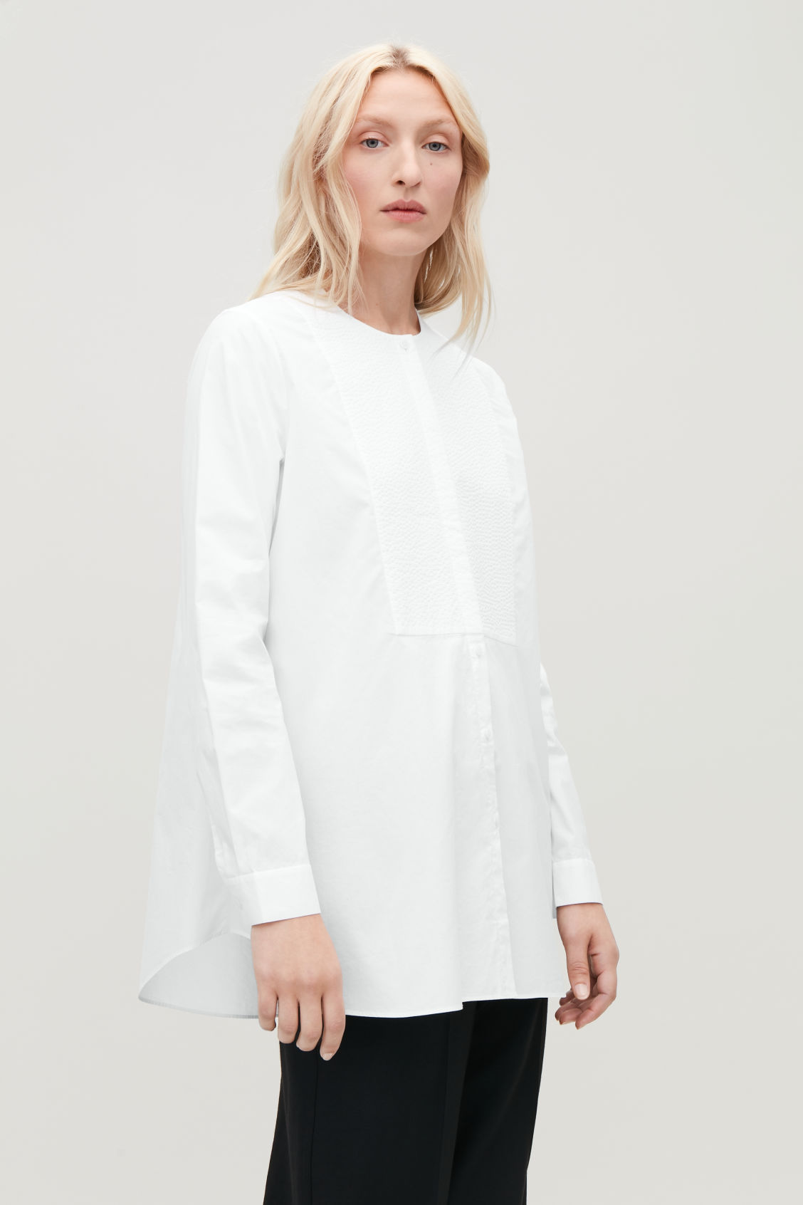 Model side image of Cos quilted bib-front shirt in white