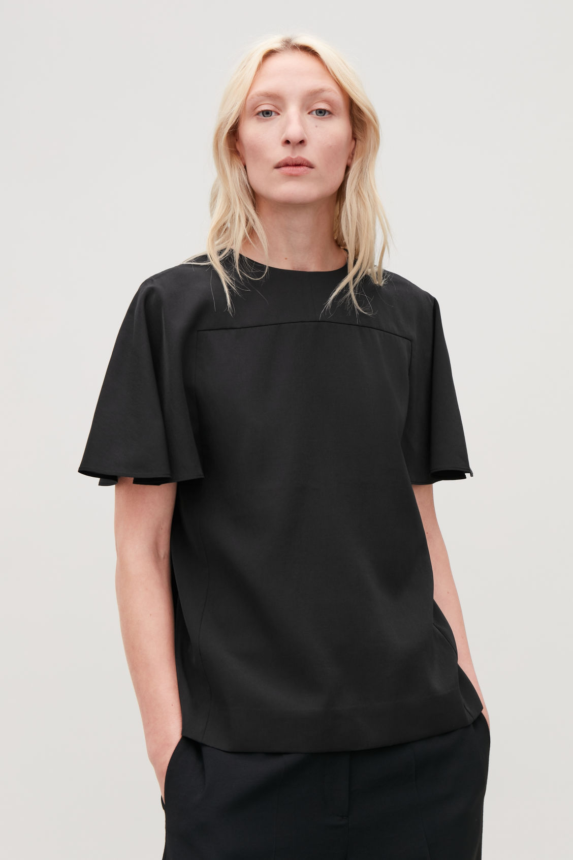 Model side image of Cos light round-neck top in black