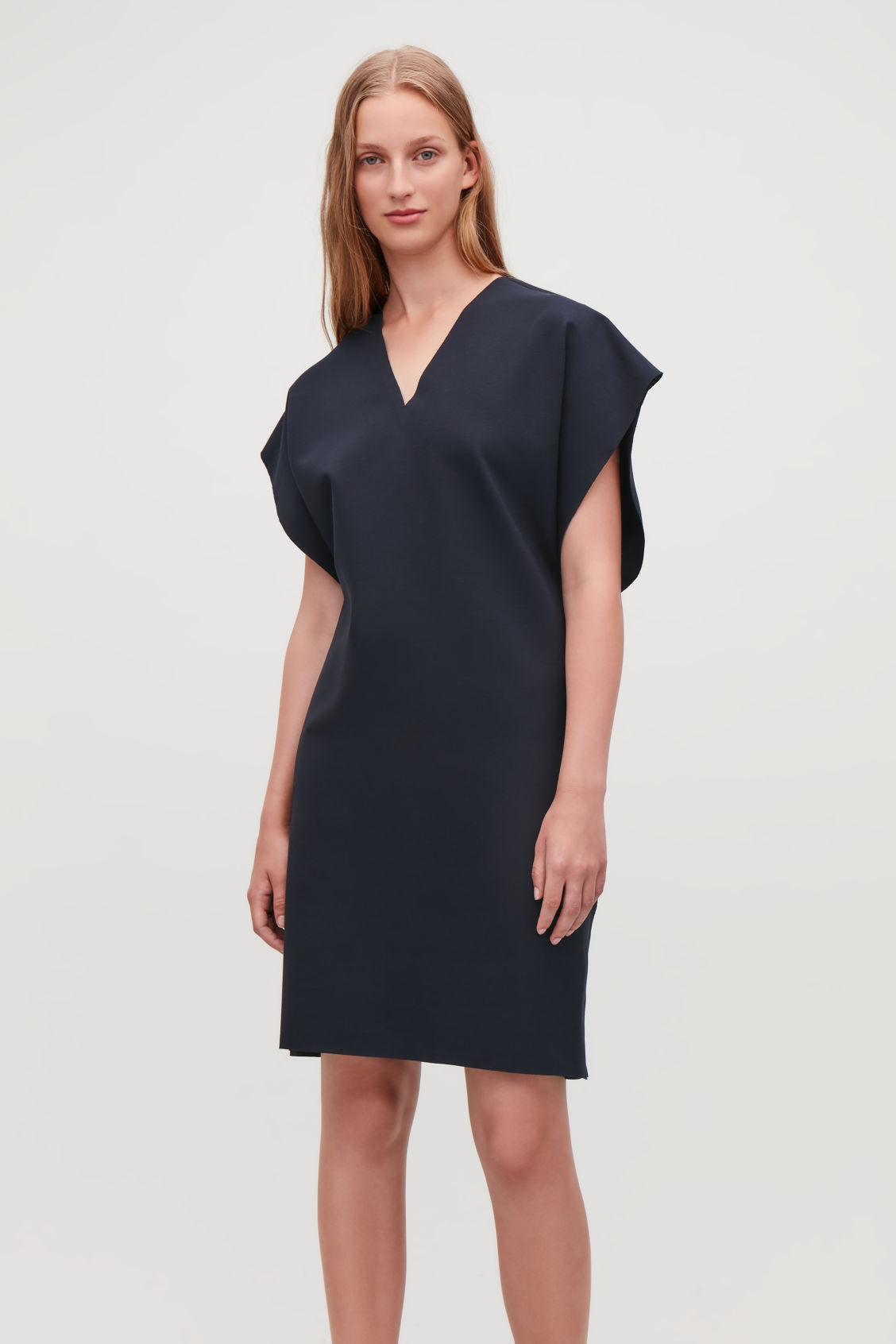 Model side image of Cos elastic-detail jersey dress in blue