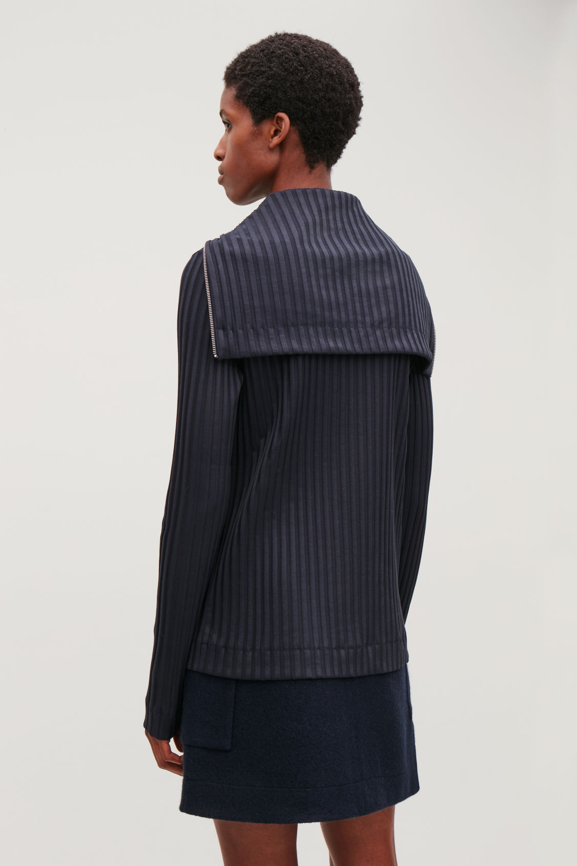 Model side image of Cos zip-up top with large collar in blue