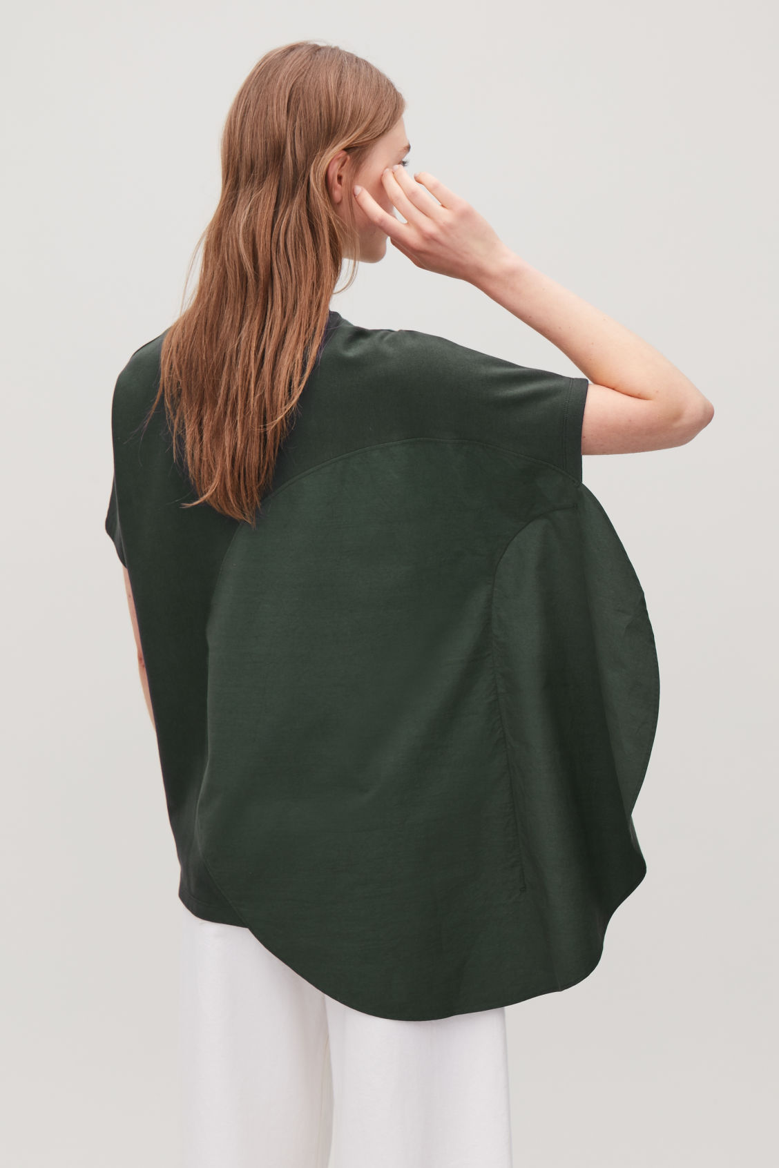 Model side image of Cos circle-panelled t-shirt in green
