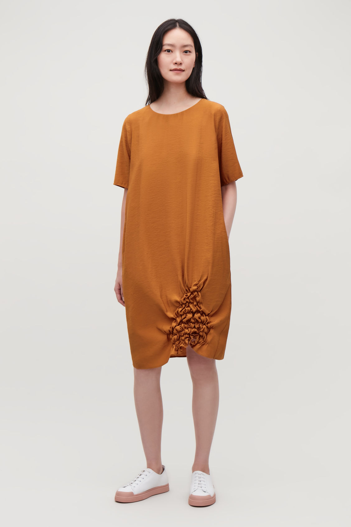 Model front image of Cos dress with gathered hem in orange