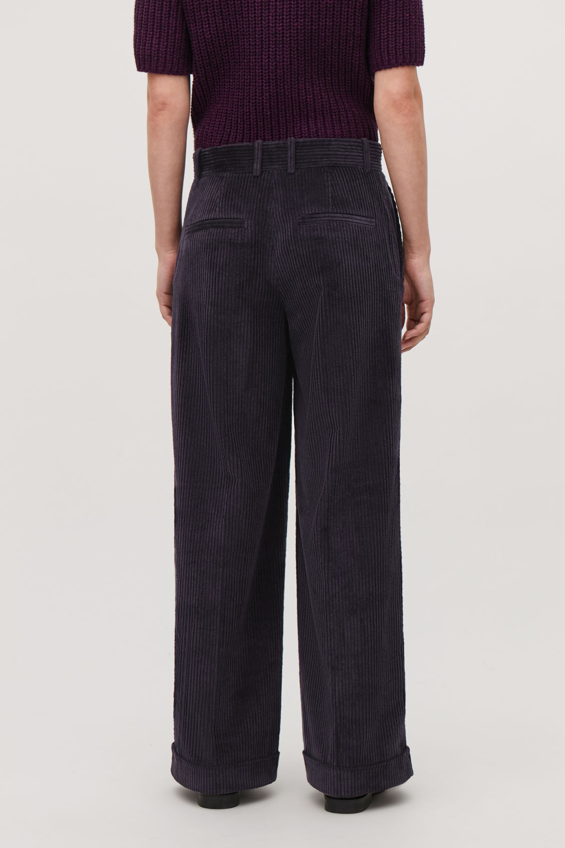 Model side image of Cos relaxed turn-up corduroy trousers  in purple