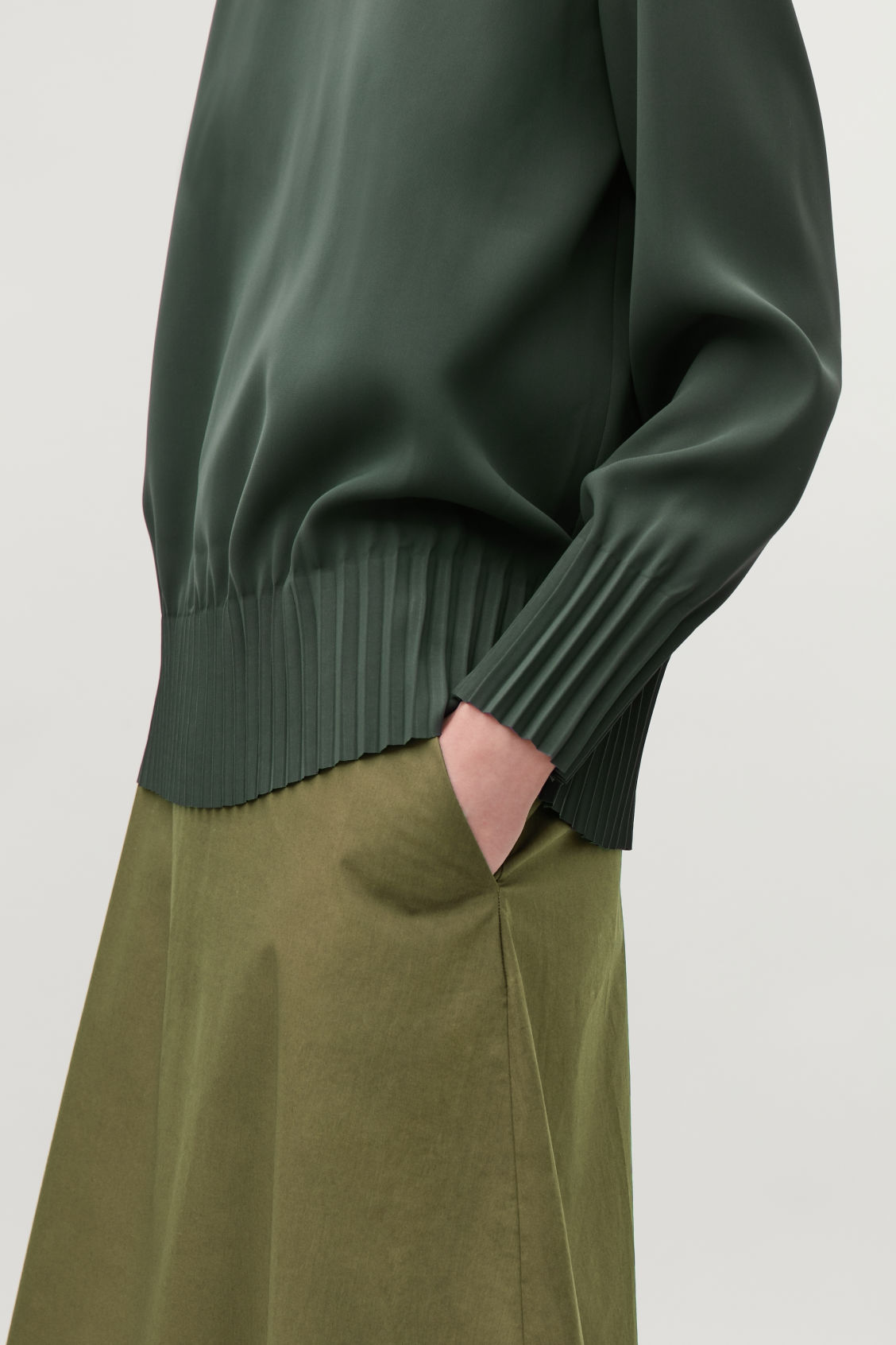 Model side image of Cos pleated blouse in green