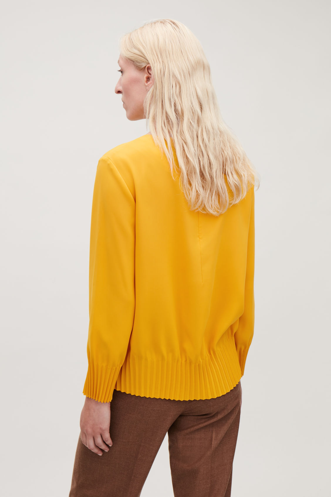 Model side image of Cos pleated blouse in yellow