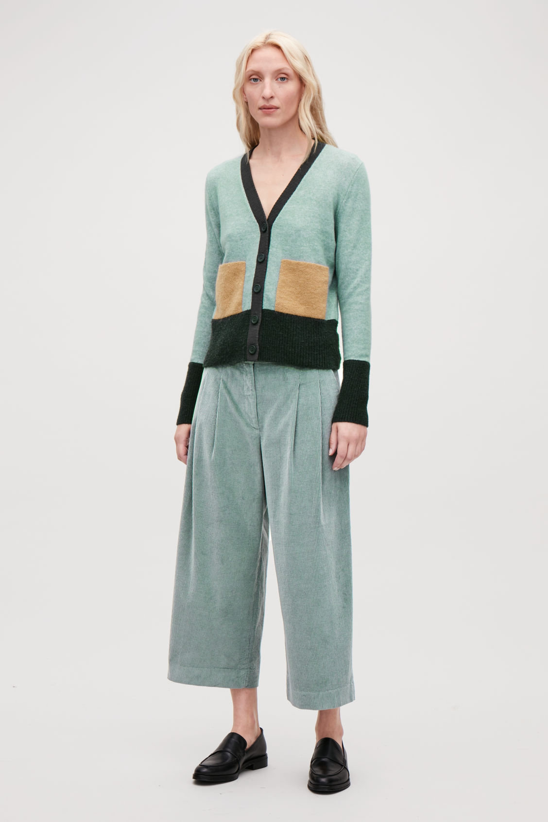 Model side image of Cos wide-leg corduroy trousers in green
