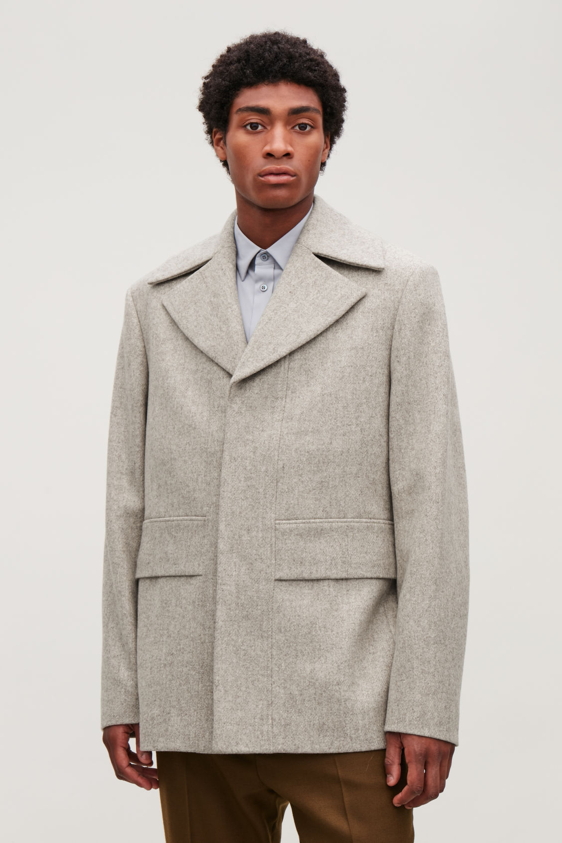 Model side image of Cos short wool peacoat in brown